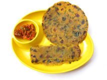 Indian Food-Thepla and Pickle. Special Gujarati food thepla is made of wheat flour and fenugreek leaves served with mango pickle Royalty Free Stock Photo