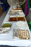 Indian food. A variety of Indian food items displayed - Yoghurt or curd, luddu sweet, halwa sweet, sambhar and rasam Royalty Free Stock Photo