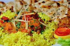Indian Food. Yellow rice and spicy chicken Stock Photography