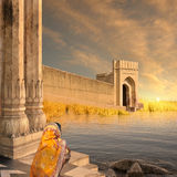 Indian fort. Woman with yellow saree near indian fort Royalty Free Stock Photos