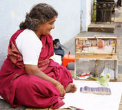 Indian fortune teller. With her parrot partner royalty free stock photos