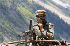 Indian frontier guard in Kashmir Himalayas. India. JAMMU AND KASHMIR, INDIA - JUNE 12, 2015 : Unknown Indian frontier guard. Indian Army checkpoint in Kashmir stock photography