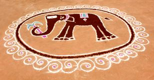 An indian funny elephant kolam design. An indian funny elephant kolam design made with white and color powders Royalty Free Stock Image