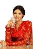 Indian girl. Beautiful young Indian girl drinks water from glass royalty free stock image