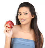 Indian girl with apple Royalty Free Stock Image