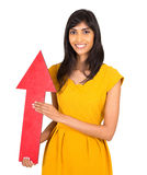 Indian girl arrow. Beautiful indian girl holding direction arrow pointing up Stock Image
