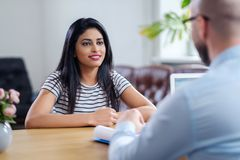 Indian girl attending job interview.  stock image