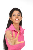 Indian girl avoiding with her hands Stock Photos