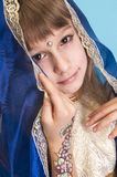 Indian girl in blue shawl Stock Images