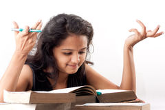Indian Girl and Books Royalty Free Stock Photography