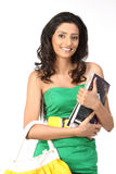 Indian girl with books and handbag Royalty Free Stock Photo