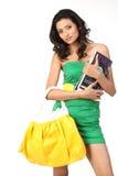 Indian girl with books and handbag Stock Photography