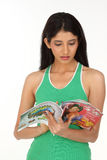 Indian girl with books on white Royalty Free Stock Images