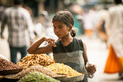 Indian girl bying sweets from the street Royalty Free Stock Image