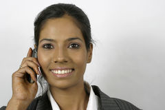 Indian girl calling on mobile phone Stock Images