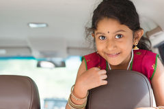 Indian girl in car Royalty Free Stock Photos