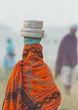 Indian. Girl carrying the food for her husband Royalty Free Stock Photo