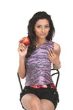 Indian girl in chair holding red apple Royalty Free Stock Image