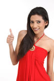 Indian girl in challenge action. Teenage girl posing in a challenge expression Royalty Free Stock Image