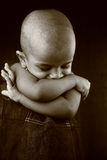 Indian girl child. Monochrome image of an Indian girl child with shaved head Stock Photo