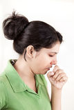 Indian girl in cold coughing Royalty Free Stock Photos