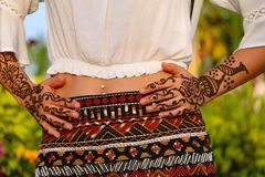 Indian girl with henna. Beautiful Cultural paint on hand and arm with hanne royalty free stock photo