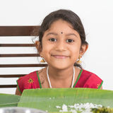 Indian girl dining. Indian family dining at home. Photo of Asian child eating rice. India culture stock images