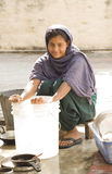 Indian Girl doing dishes Royalty Free Stock Image
