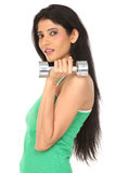 Indian girl with dumb bells Royalty Free Stock Photos