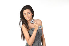 Indian girl with dumb bells. Indian teenage girl with dumb bells Stock Photos