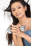Indian girl with dumb bells. Slim girl holding the dumb bells Stock Images