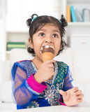 Indian girl eating ice cream. Stock Image