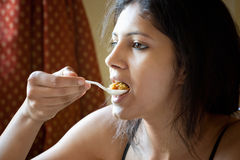 Indian Girl eating rice Royalty Free Stock Images