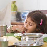 Indian girl eating rice Royalty Free Stock Photo