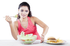 Indian Girl Eating Vegetable Salad Royalty Free Stock Images