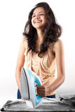 Indian girl and electric steam iron Royalty Free Stock Photo