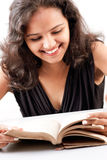 Indian girl enjoing reading book Stock Images