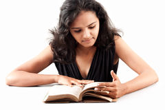 Indian girl enjoing reading book Royalty Free Stock Photo
