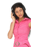 Indian girl enjoying music Stock Photography