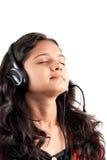 Indian girl enjoying music Stock Image