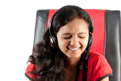 Indian girl enjoying music Royalty Free Stock Photos