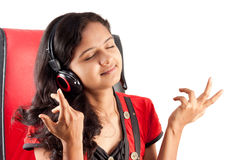 Indian girl enjoying music Royalty Free Stock Images