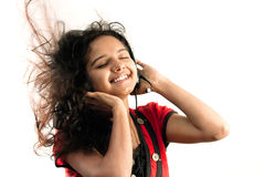 Indian girl enjoying music Stock Images