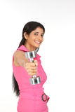 Indian  girl exercising with dumbbell Stock Image