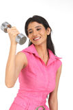 Indian  girl exercising with dumbbell Royalty Free Stock Photos