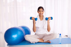 Indian girl exercising dumbbells Royalty Free Stock Photography