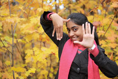 Indian Girl in Fall Season Stock Image