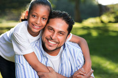 Indian girl father. Beautiful young indian girl with her father outdoors Royalty Free Stock Images