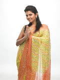 Indian girl in folded hands. Indian girl in sari with folded hands royalty free stock photography