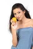 Indian girl with fresh juicy orange Stock Photography